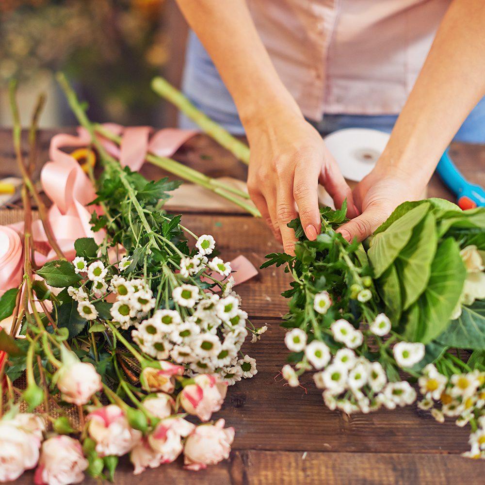 Female florist making floral bouquets in workshop